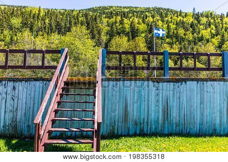 Stairs or steps with blue flag in rest area in the Gaspe Peninsula Quebec Canada Gaspesie region