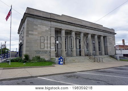 CADILLAC, MICHIGAN / UNITED STATES -  MAY 31, 2017: The historic United States Post Office building, with its Corinthian columns, in downtown Cadillac.