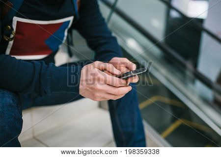 A man uses mobile phone applications for social communication. Mobile connection.