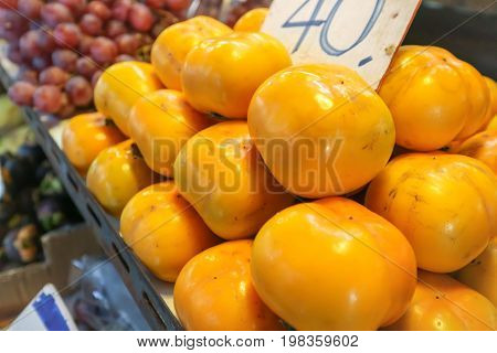 persimmon fruit on the shelf , pile of persimmons