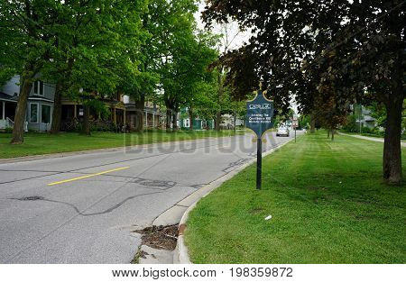 CADILLAC, MICHIGAN / UNITED STATES -  MAY 31, 2017: A sign welcomes visitors to Cadillac's Courthouse Hill Historic District, where residents live in preserved historic homes.