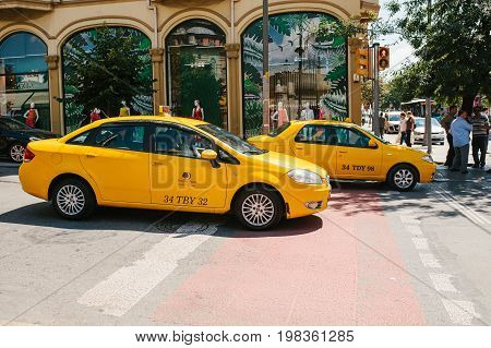Istanbul, June 11, 2017: A traditional yellow taxi rides on the street in the Fatih district of Istanbul, Turkey. Urban life style. Transportation of passengers. A business.