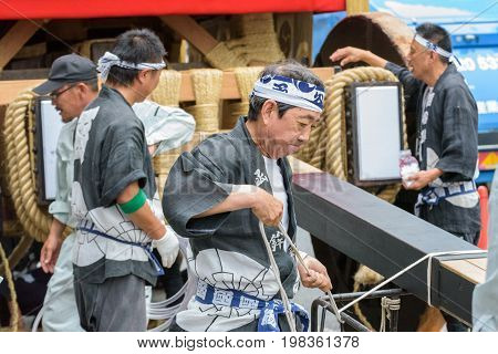 Kyoto, Japan – July 17, 2016: Japanese Men In Traditional Clothing Preparing Yamaboko Float In Gion