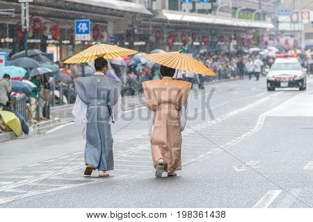 Kyoto, Japan - July 17, 2016: Japanese Men In Traditional Clothi