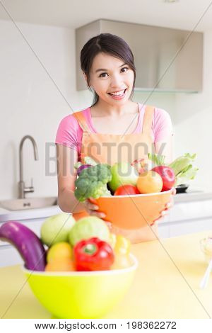 beauty housewife smile happily in the kitchen