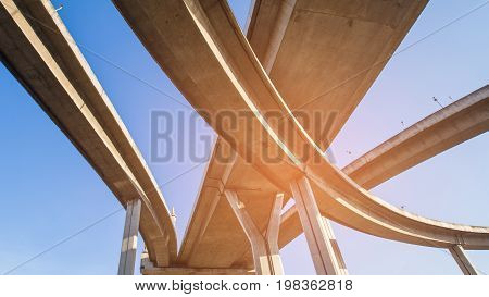 Highway overpass intersection bottom view with clear blue sky background
