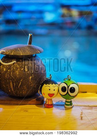 Couple key chain so sweet beside the coconut shell.