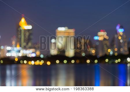 Night city downtown blurred bokeh light water front abstract background