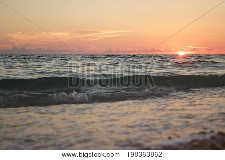 A smooth rolling waves laps at the shoreline of Saint Petersburg Beach, Florida