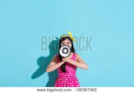 Girl Wearing Cute Dress On Blue Background
