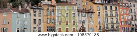 Buildings of different shapes and colors in the city of Grenoble, France