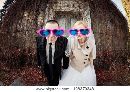 Cheerful Wedding Couple In Glasses In The Form Of Heart