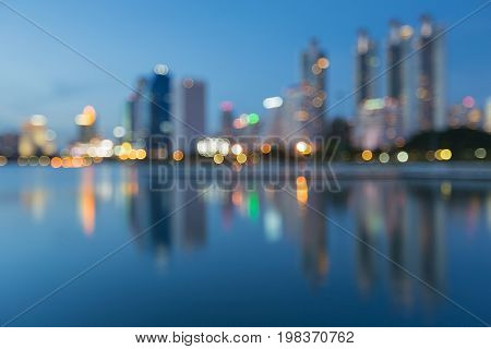 Reflection blurred light office building at twilight abstract background
