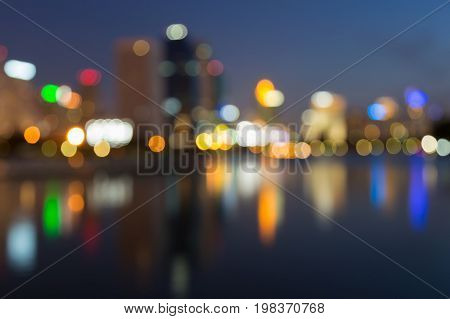 Blurred bokeh city light with water reflection abstract background