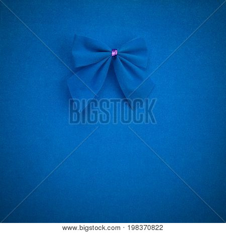 blue bow on a blue background with vignette. mock up for text congratulations phrases lettering