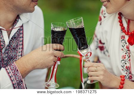 Couple At A Picnic Drinks In Glasses Wine