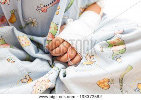 Sick children in hospital, saline solution intravenously.