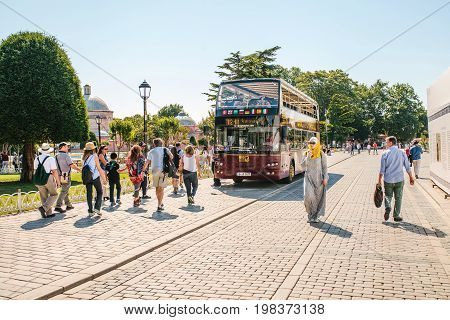 Editorial image of tourist sightseeing bus picking up passengers at the stop at Sultanahmet square in Istanbul on June 15, 2017.