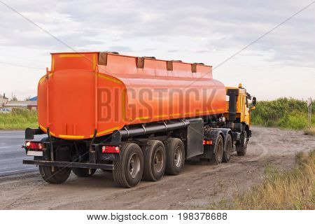 Lorry With Orange Tanker On Parked On The Roadside