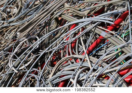 Background Of Many Abandoned Electrical Wires In A Recyclable Ma