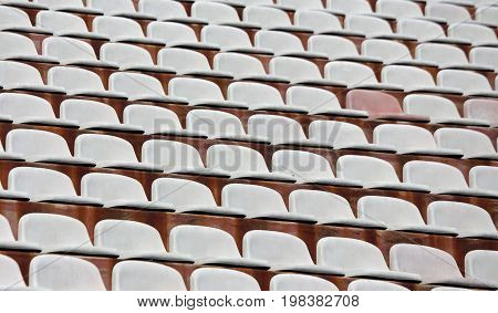 White Seats On Stadium Bleachers With No People