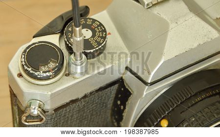 classic shutter cable released operated on film camera ready to shooting