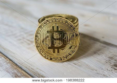 Golden Bitcoins On A Wooden Table. Photo New Virtual Money