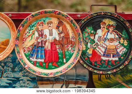 KIEVUKRAINE-18 JULY 2017.Traditional ukrainian wooden plates with hand made painting.