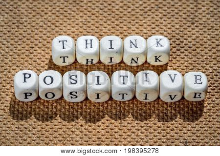 think positive words made from toy cubes with letters