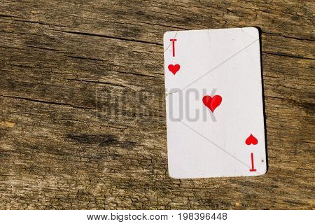 Ace Of Hearts On Old Wooden Background
