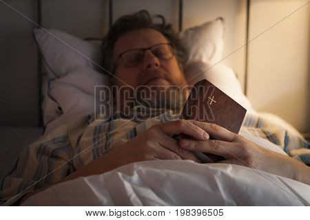Middle-aged man fell asleep with his Bible