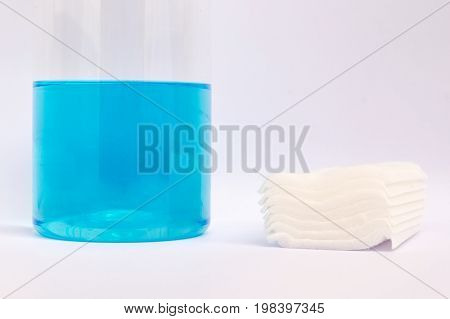 cotton bandage and blue alcohol for medical in the plastic bottle on white background