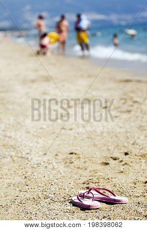 Sandals on the beach on a sandy beach