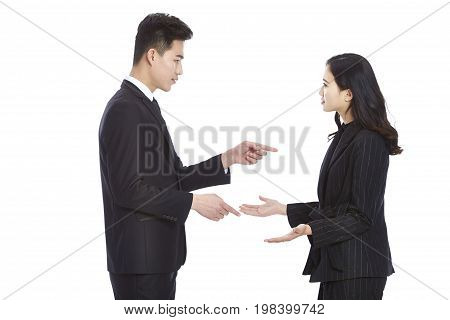 young asian business man and woman in formal wear having a serious argument isolated on white background.
