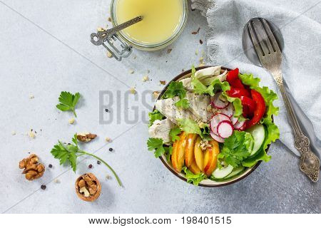 Summer Lettuce With Salad Dressing Vinaigrette. Salad With Chicken, Fresh Vegetables, Walnuts And Gr