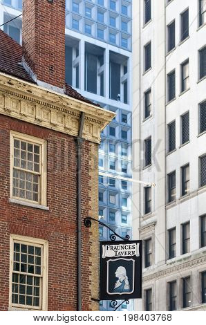 New York City USA - February 1 2009: Tall buildings loom over historic Fraunces Tavern where George Washington celebrated the end of the American Revolution