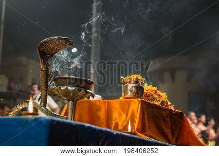 Candles used in performance of religious Ganga Aarti ritual fire puja at Dashashwamedh Ghat in Varanasi, Uttar Pradesh, India.