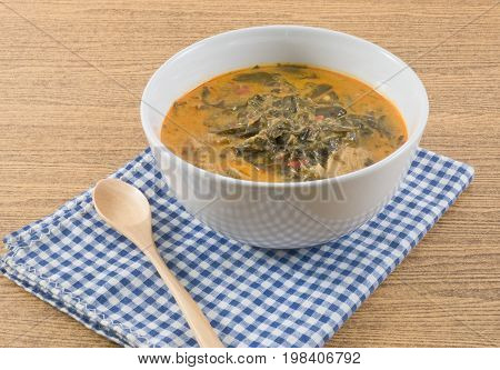 Thai Cuisine and Food A Bowl Thai Spicy Coconut Milk Cream Based Curry with Cassia Leaves and Grilled Beef Fillet.