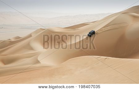 Car Driving In Rub Al Khali Desert At The Empty Quarter, In Abu Dhabi, Uae