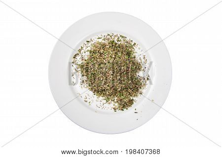 Mixed spices on a white plate cut out and isolated on a white background