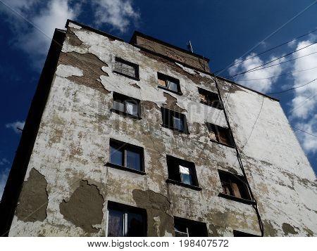 Old building. Old multi-storey building. Grunge building. Grunge. Grunge stucco. Old architecture. Architecture. White building. Building background.