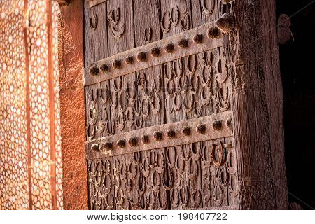Door with horseshoes at antient abandoned city of Fatehpur Sikri n the Agra District of Uttar Pradesh, India.