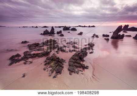 Morning Low tide. Sunrise sand beach near the Noja town, Cantabria, Northern Spain