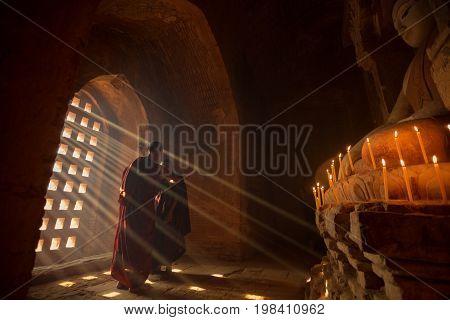Two novice monks in the pagoda Bagan Mandalay Myanmar