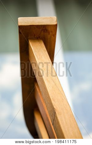 light brown wood arm rest abstract close up