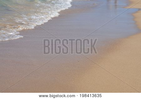 Soft wave of the sea in the corner of sandy beach texture clear sandy beach natural background