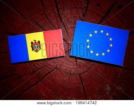 Moldovan Flag With Eu Flag On A Tree Stump Isolated