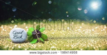 Abstract background with four leaf lucky clover and stone as copy space