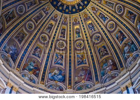 Rome, Vatican, Italy - July, 2, 2017: fragment of the ceiling list in St. Peter's Cathedral in Vatican, Rome, Italy