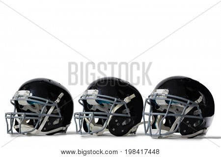 Close up of black sports helmets arranged side by side on white background